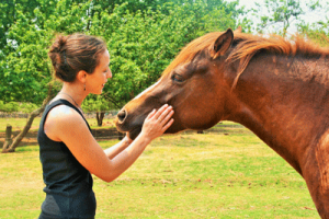 Girl communicating with her horse